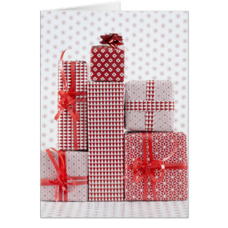 Stack of red patterned wrapped presents card