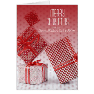 Stack of red wrapped presents greeting card