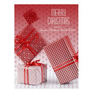 Stack of red wrapped presents postcard