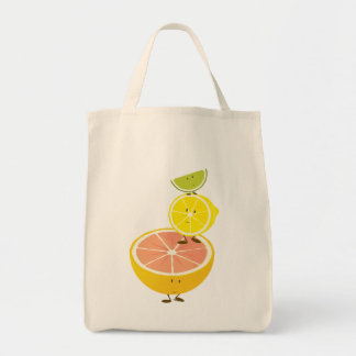 Stack of smiling citrus fruit bags
