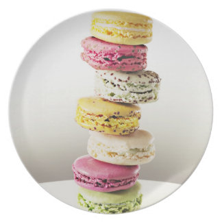 Stack of vibrant macaroons party plates