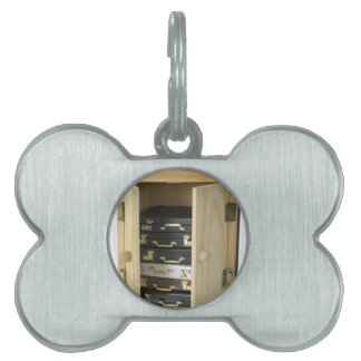 StackBriefcasesInArmoire070515 Pet Tag