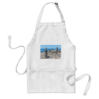 Stacked beach stones at blue sea adult apron