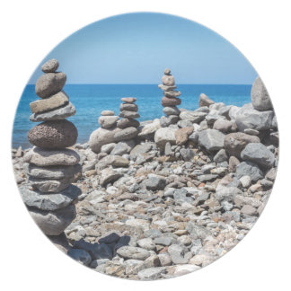 Stacked beach stones at blue sea melamine plate