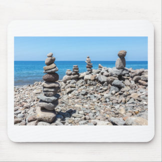 Stacked beach stones at blue sea mouse pad