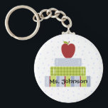 "Stacked Books Teacher&#39;s Key Chain<br><div class=""desc"">Great teacher&#39;s key chain,  with graphic artwork of a stack of colorful books,  with an apple on top,  against a blue and white polka dot background. Personalize the black text with your teacher&#39;s name. Perfect little gift for that special teacher.</div>"