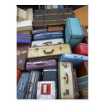 Stacked suitcases post cards