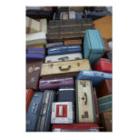 Stacked suitcases posters