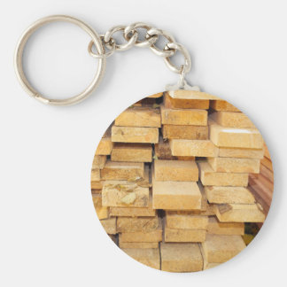 Stacks of new pine boards for the construction basic round button keychain