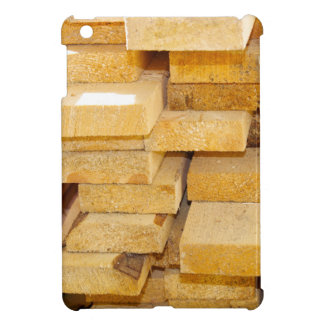 Stacks of new pine boards for the construction of iPad mini cases