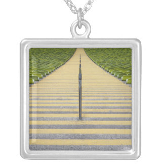 Stadium stairway between rows of green seats silver plated necklace