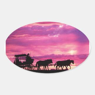 Stagecoach At Sunset Oval Sticker