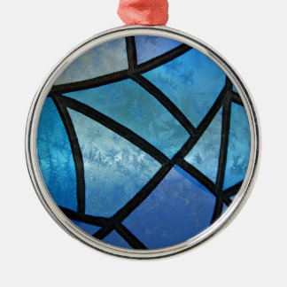Stained glass background with ice flowers metal ornament