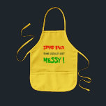 """Stand Back This Could Get Messy - child&#39;s Kids&#39; Apron<br><div class=""""desc"""">Stand Back This Could Get Messy - a child&#39;s apron for messing around in the kitchen,  or with crafts.  It has bright red,  blue and green bright lettering on a yellow apron.</div>"""