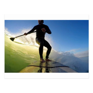 Stand up paddle board surfing a green wave postcard