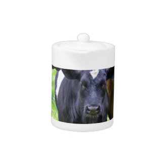 Standing brown mother cow with black white calf teapot