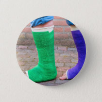 Standing child with two colorful gypsum legs pinback button