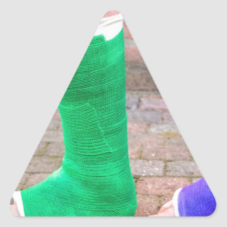 Standing child with two colorful gypsum legs triangle sticker