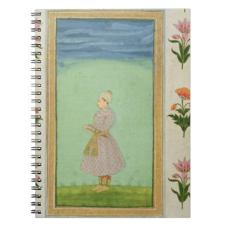 Standing figure of a boy with a jewelled dagger in notebook