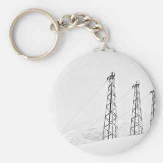 Standing tall in snow fall basic round button keychain