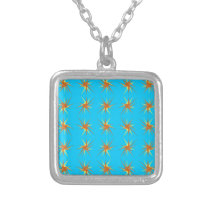 Star bursts pattern in cream and beige, turquoise silver plated necklace