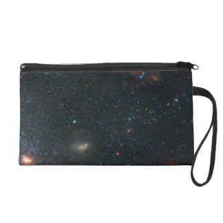 Star Clusters and Distant, Red Galaxies Near Edge Wristlet Purses