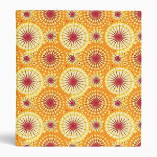 Starbursts and pinwheels, saffron and raisin 3 ring binder