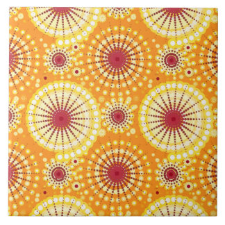 Starbursts and pinwheels, saffron and raisin ceramic tile