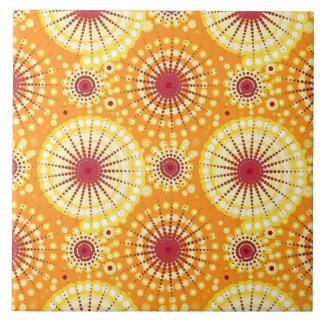 Starbursts and pinwheels, saffron and raisin ceramic tile