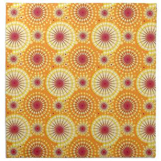 Starbursts and pinwheels, saffron and raisin cloth napkin