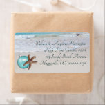 """Starfish Beach Christmas Wide Return address label<br><div class=""""desc"""">Starfish and ornament decorated beach address labels. These wide labels will hold up to 5 lines of text in elegant printed font style, which is easy to read. Smooth beach sand and waves lapping at the shore is the image behind the design. Choose this size or shipping label size. Remove...</div>"""
