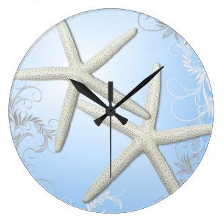 Starfish Flourish on Blue Wall Clock