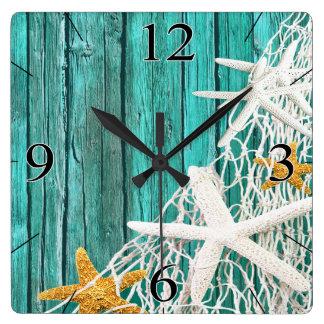 Starfish Netting Beach Wood Coastal Living | aqua Square Wall Clock