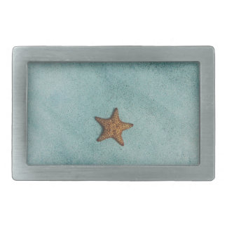 Starfish on a Turquiose Beach Background Belt Buckle