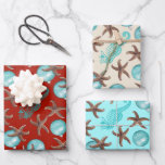 """Starfish Sea Horses Christmas Gift Wrapping Sheets<br><div class=""""desc"""">Beach themed gift wrapping paper sheets with starfish and sea horses. Each sheet has the same design but in three colors. Aqua blue ornaments, brown sea stars and blue sea horses are printed in a larger pattern over dark red, beige and light blue. Each sheet is large (19x29 in.) to...</div>"""