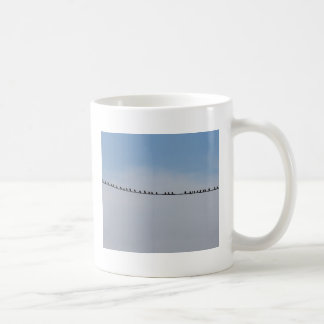 Starlings on a wire coffee mugs