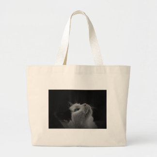 Starry night sky black & white cat with blue eyes tote bags