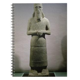 Statue dedicated to the god Haddad-Yishi (basalt) Spiral Notebook