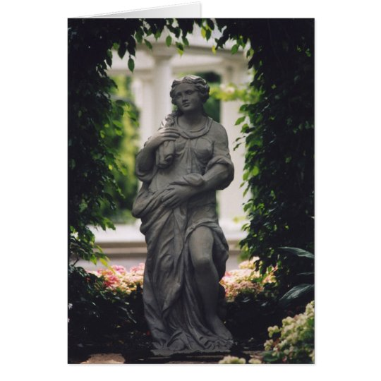 Statue framed by greenery card