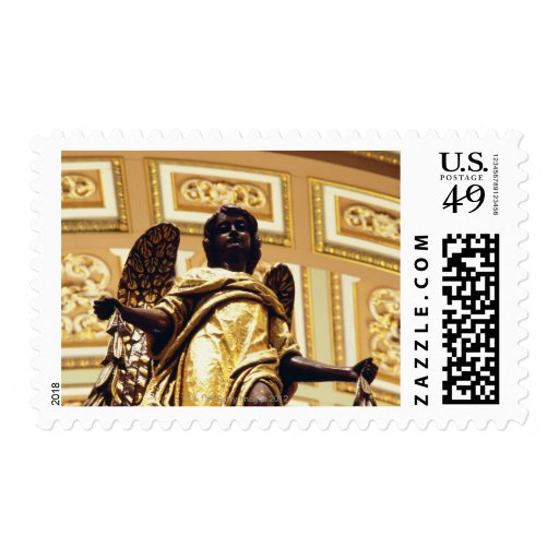 Statue of angel in gold postage