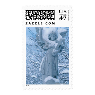 Statue of angel in outdoors in winter postage