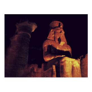 Statue of king in Luxor Temple in Egypt by night Postcard