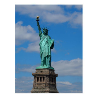 Statue of Liberty against a blue sky Postcard
