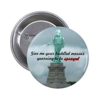 Statue of Pepper Spray Cop Button