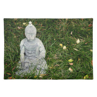 statue on leaf covered lawn placemat