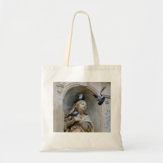 Statue with pigeons tote bag