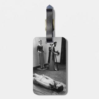Statues of catholic saints bag tags