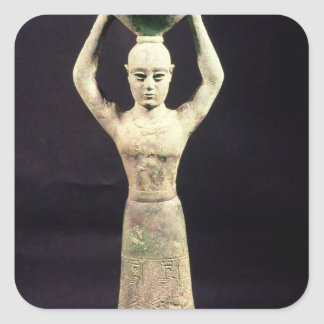 Statuette of offering bearer with votive sticker
