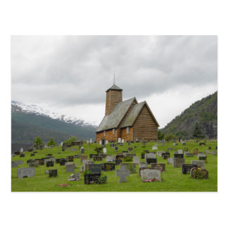 Stave church with graveyard in Norway postcard