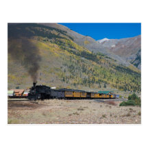 Steam train leaving town postcard